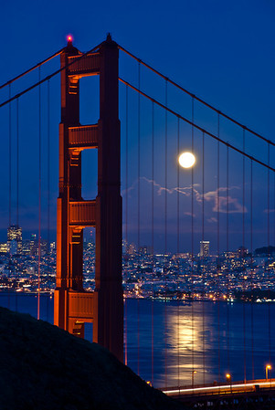Moon rising along side the North Tower of the Golden Gate Bridge.